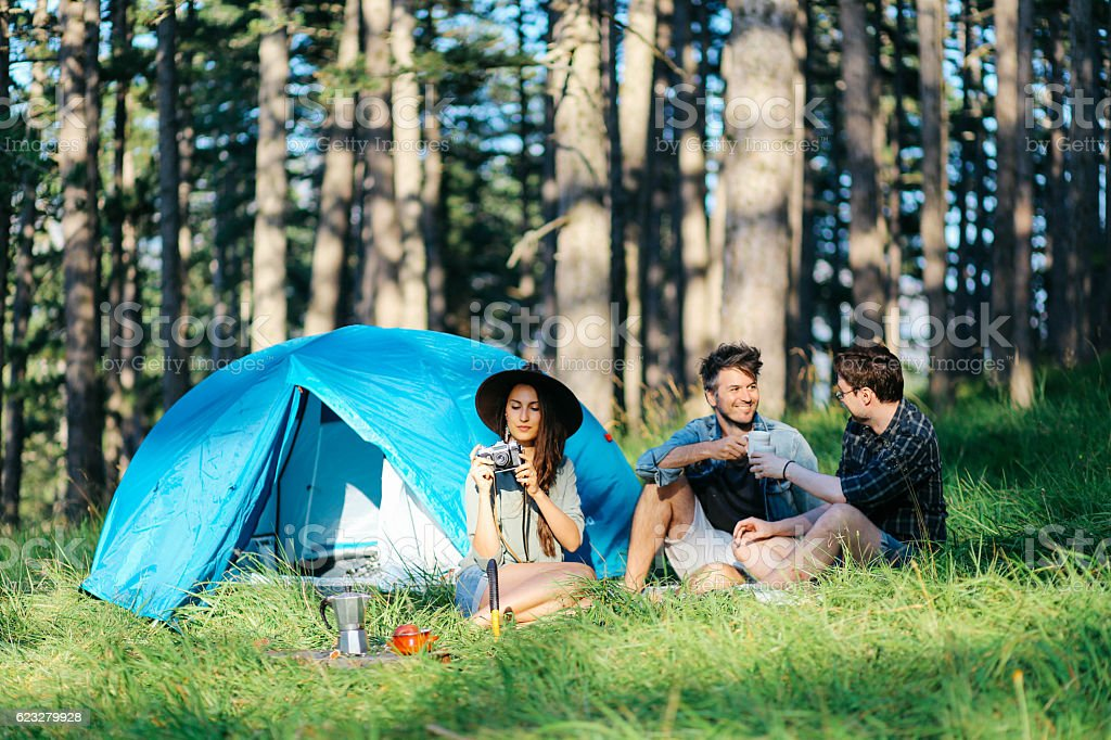 Young people camping stock photo