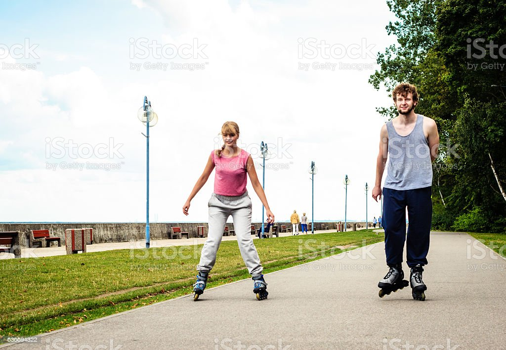 Young people casually rollblading together. stock photo