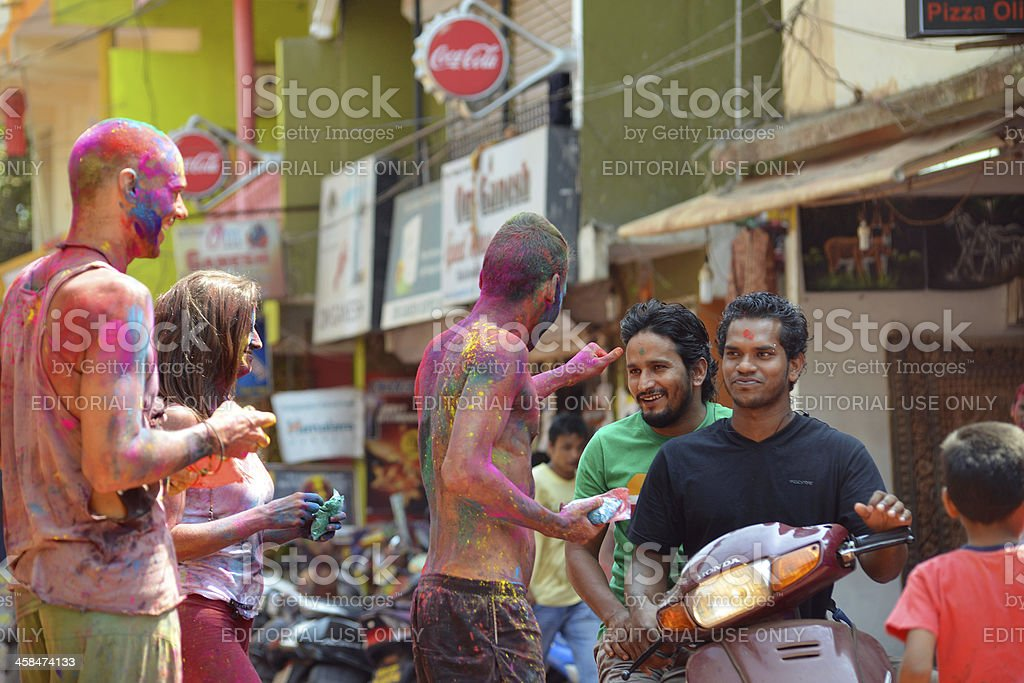 Young people celebrate Holi festival in India royalty-free stock photo