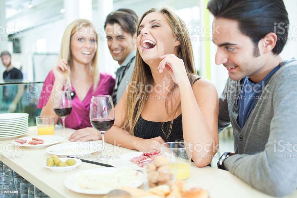 Young people celebrating in bar stock photo