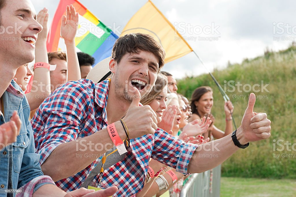 Young people cheering at festival stock photo