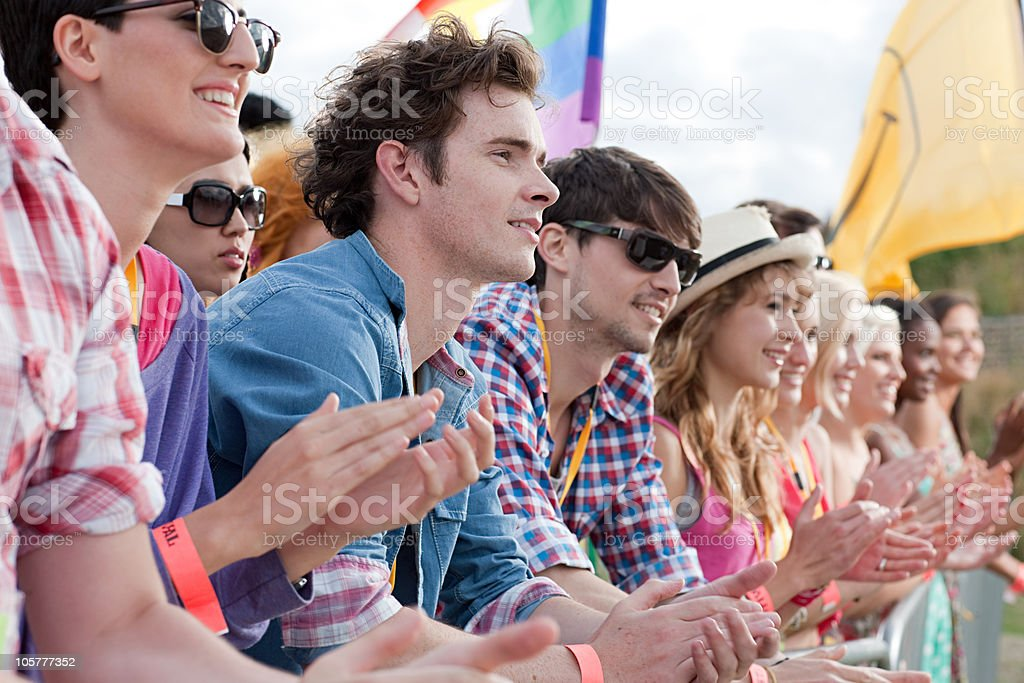 Young people clapping at festival stock photo