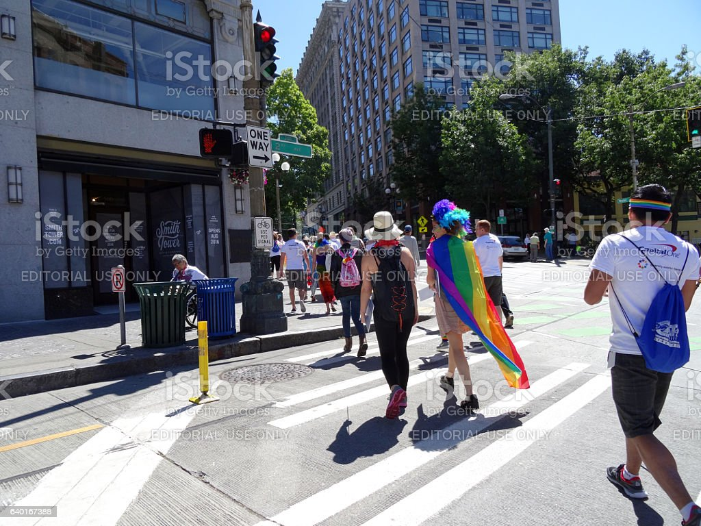 Young people cross street dressed up for Seattle Gay stock photo