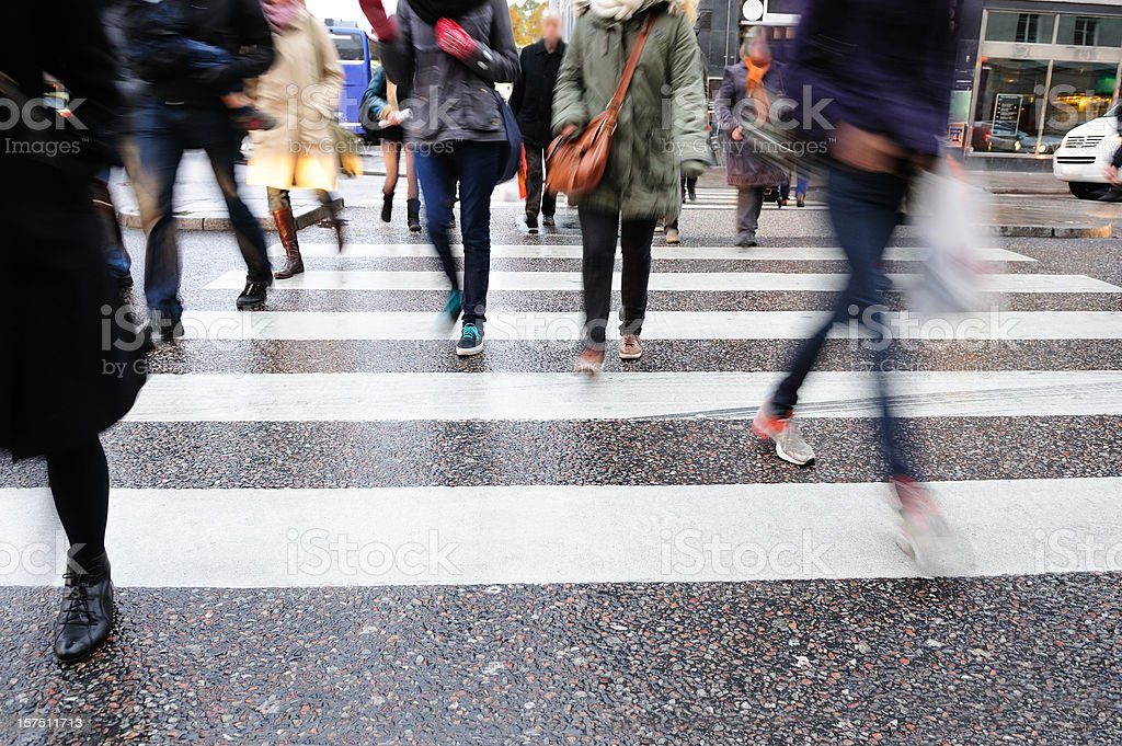 Young people crossing street, motion blur royalty-free stock photo
