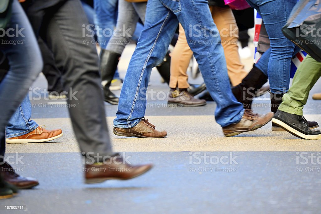 Young people crossing street, motion blur stock photo