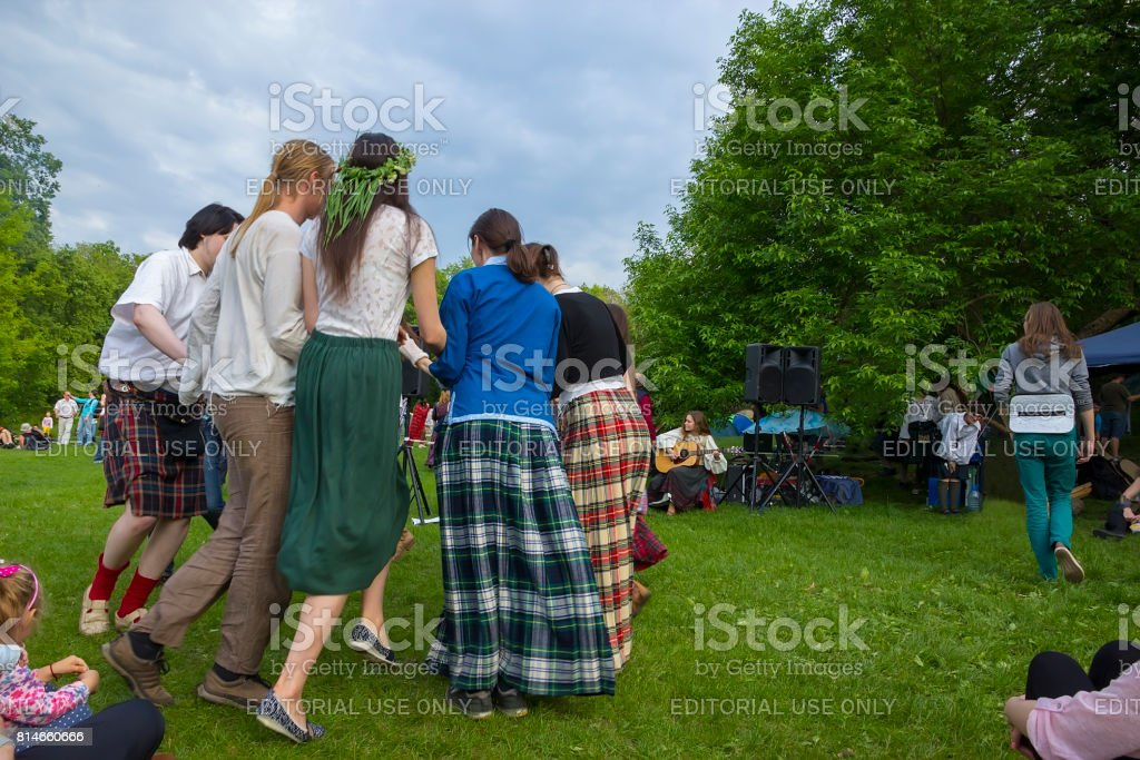Young people dance round dance in the open air stock photo