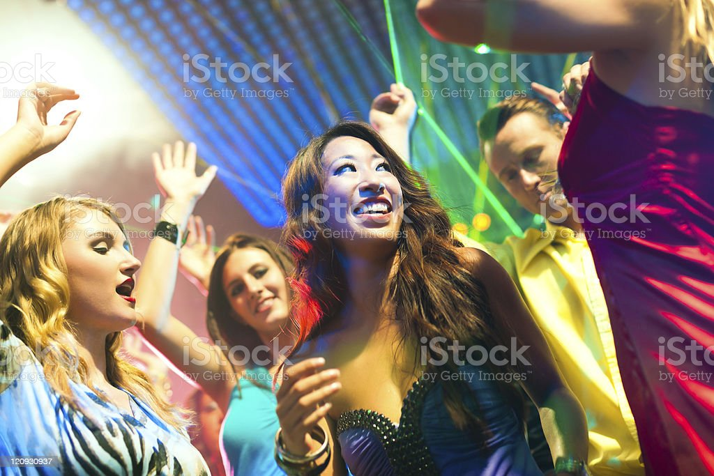 Young people dancing at disco club royalty-free stock photo