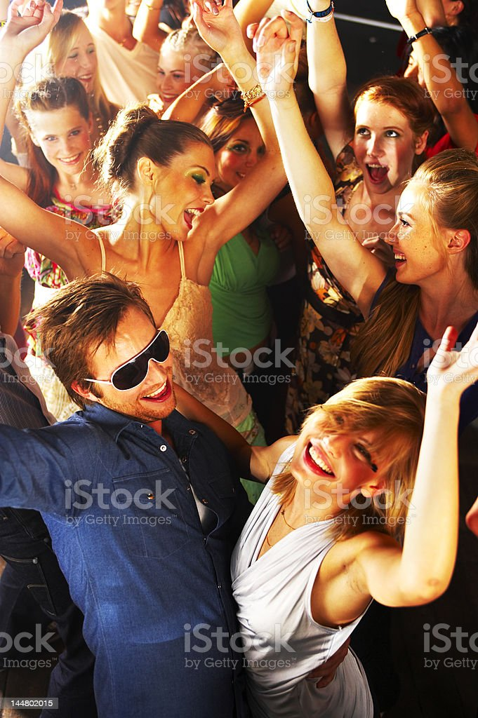 Young people dancing to the music at a nightclub royalty-free stock photo