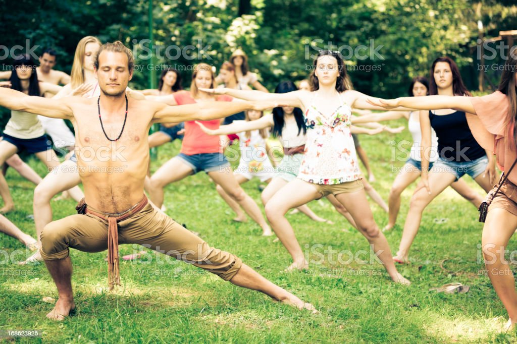 young people doing yoga royalty-free stock photo