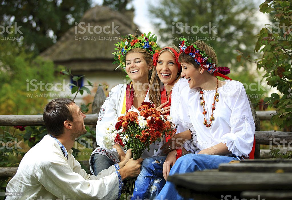 Young people dressed in Ukrainian shirts flirting royalty-free stock photo