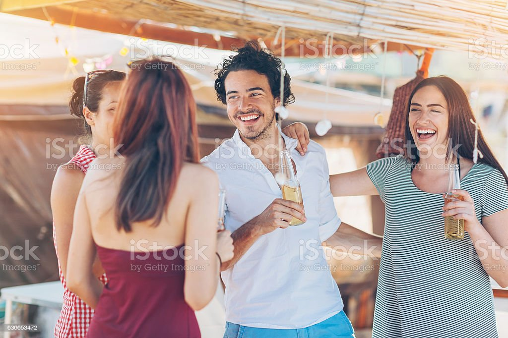 Young people drinking beer in the summer stock photo