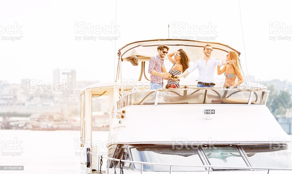 Young People Drive Yacht and having fun. stock photo