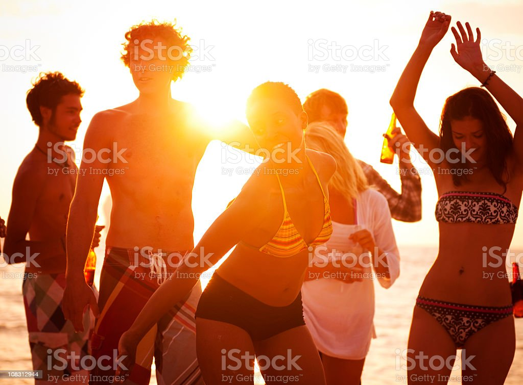 Young People Enjoying a Summer Beach Party. stock photo