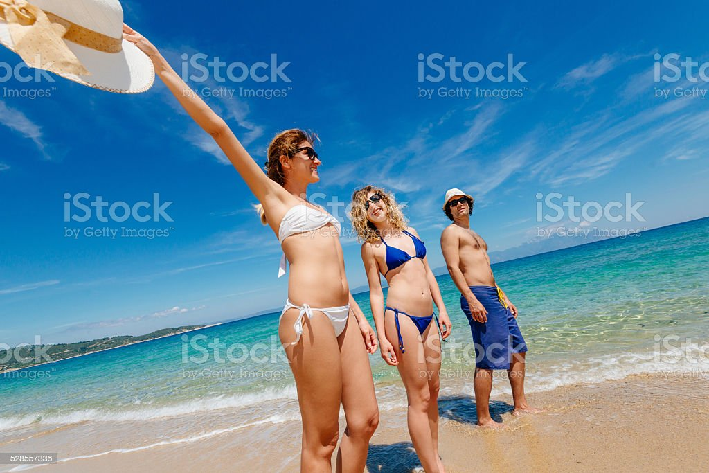Young people enjoying summer holiday at beach on Greek island stock photo
