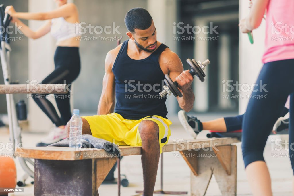 Young people exercising in an urban gym stock photo