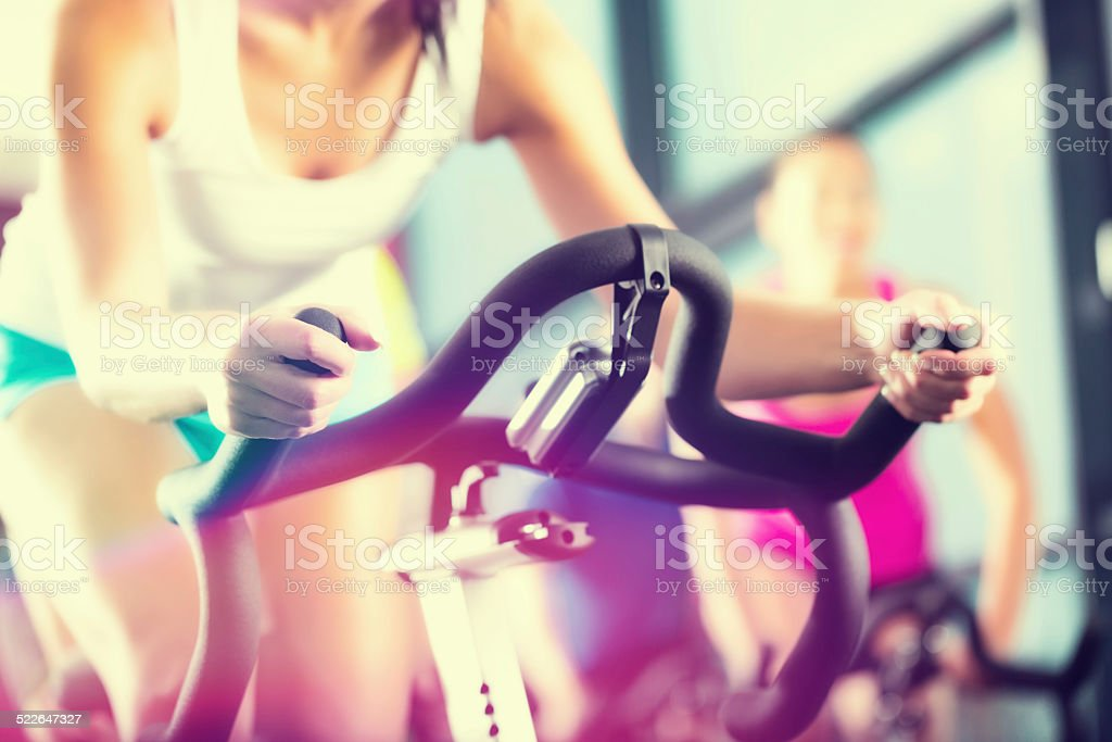 Young People Spinning in the fitness gym stock photo