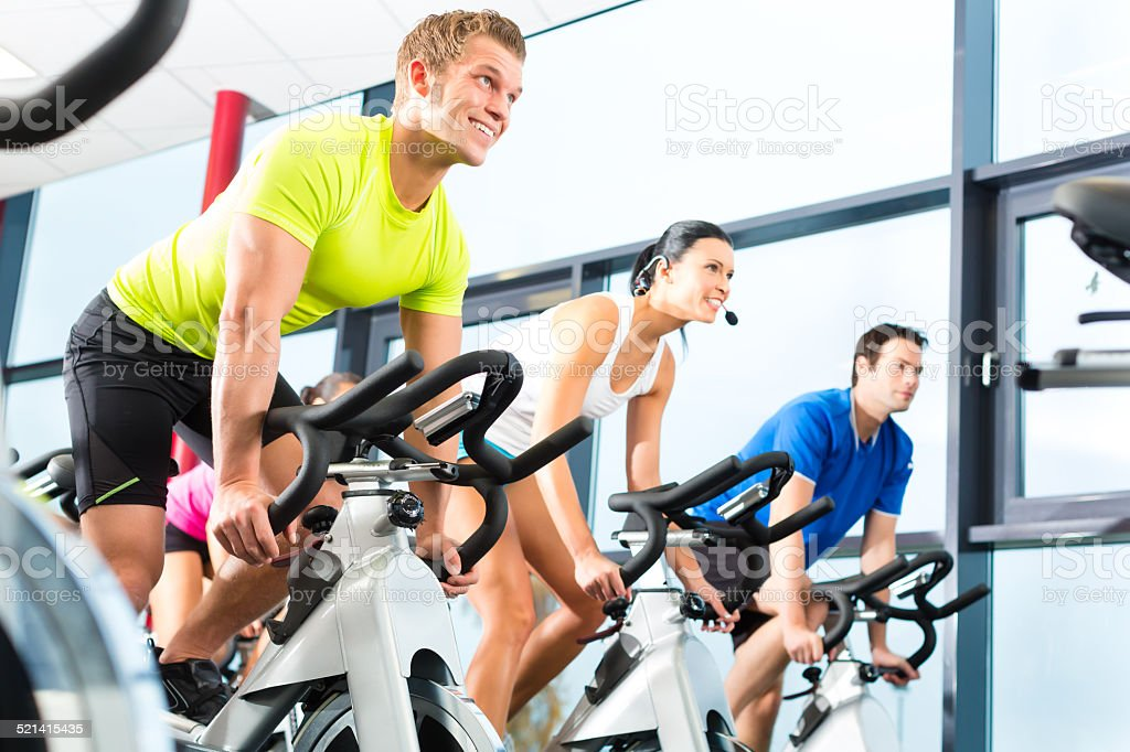 Young People Spinning in the gym stock photo