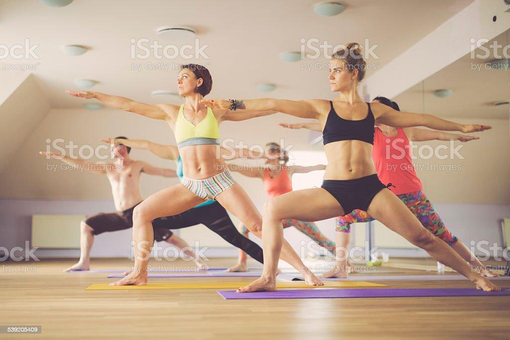 Young people exercising yoga stock photo