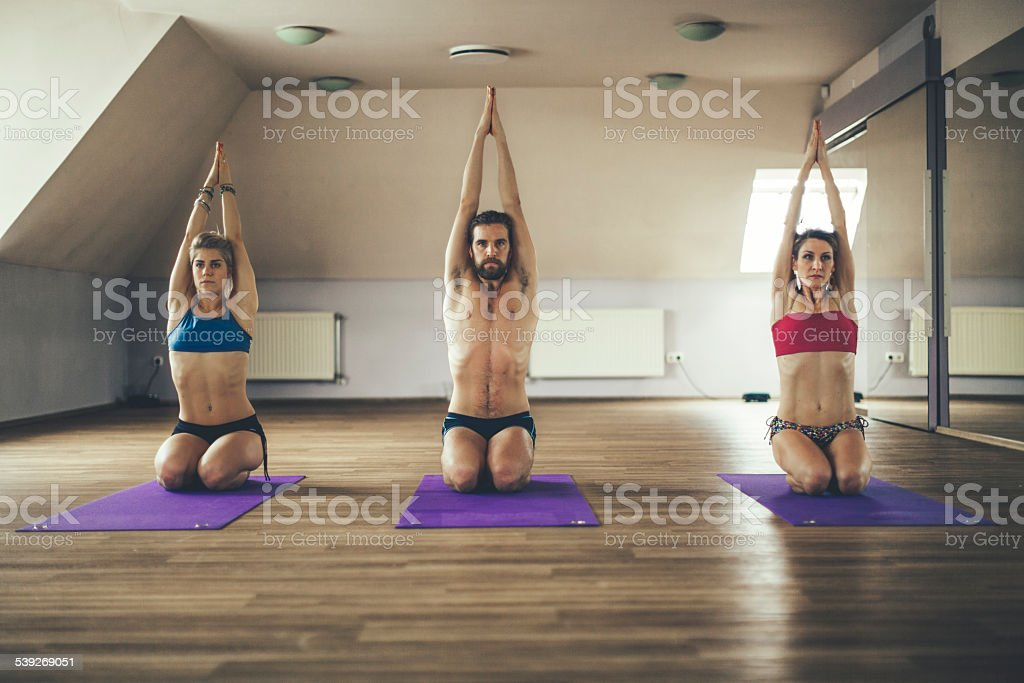Young people exercising yoga stock photo