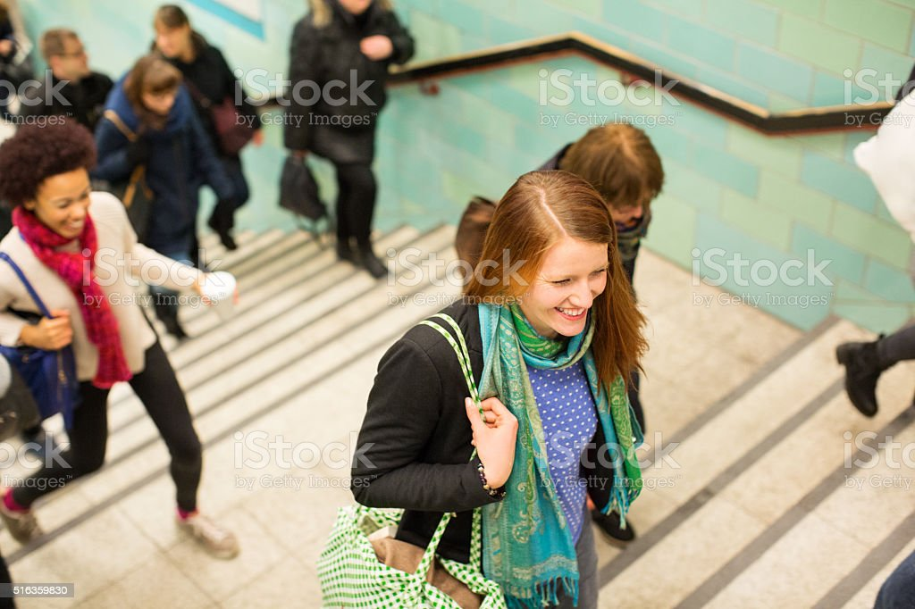 Young people exiting the subway stock photo