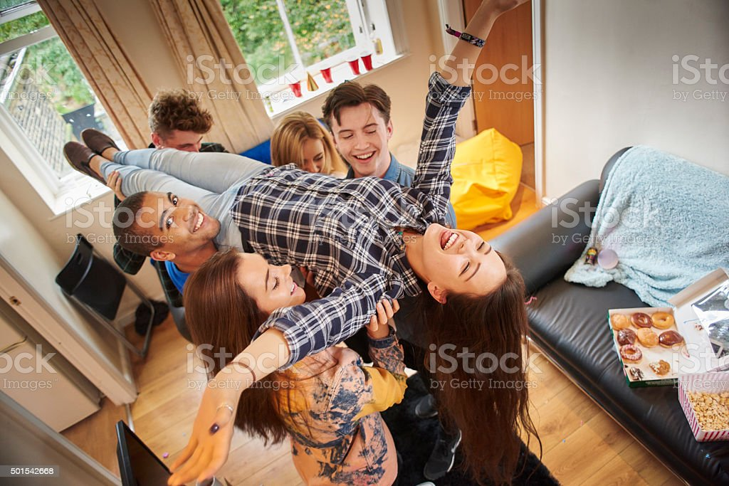 young people goofing around stock photo
