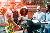 Young People Havin Fun At Barbecue Party.