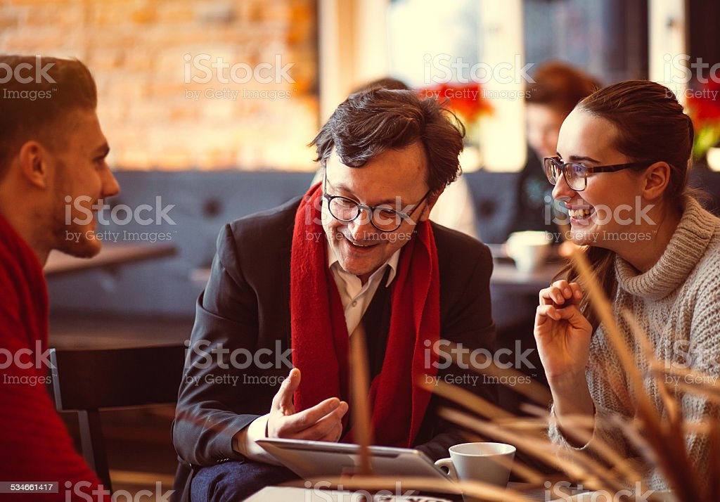 Young people having a business meeting at the coffee bar stock photo
