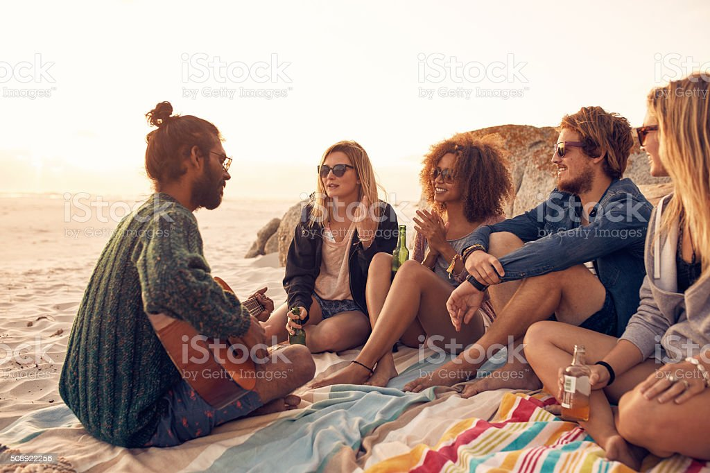 Young people having a party on the beach stock photo