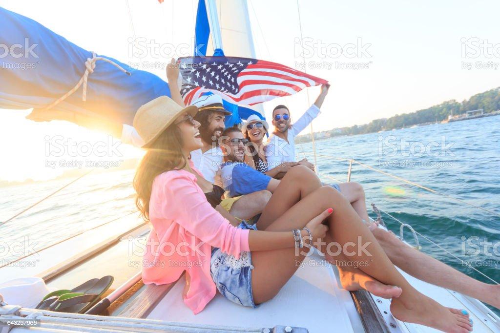 Young people having fun and sailing in sea stock photo