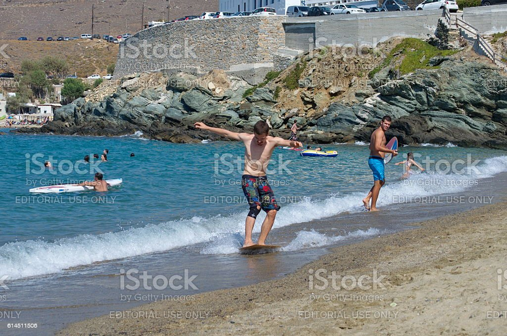 Young people having fun at  a Beach in Tinos Island stock photo