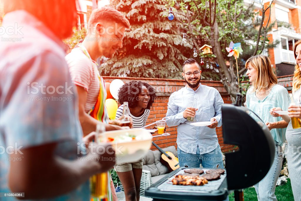 Young People Having Fun At Barbecue Party. stock photo