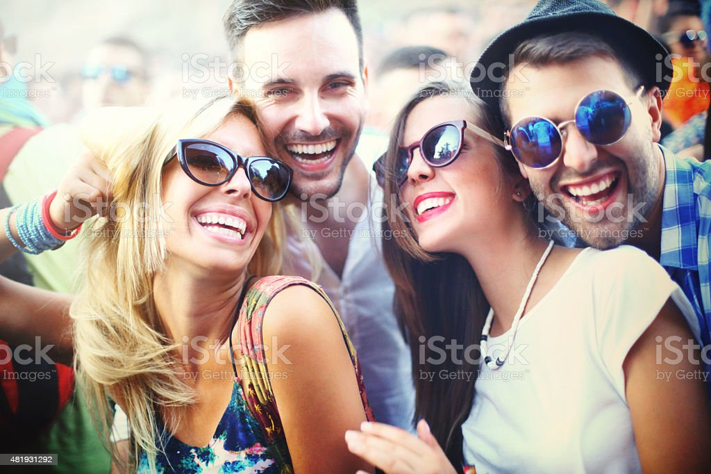 Young people having fun at concert. stock photo