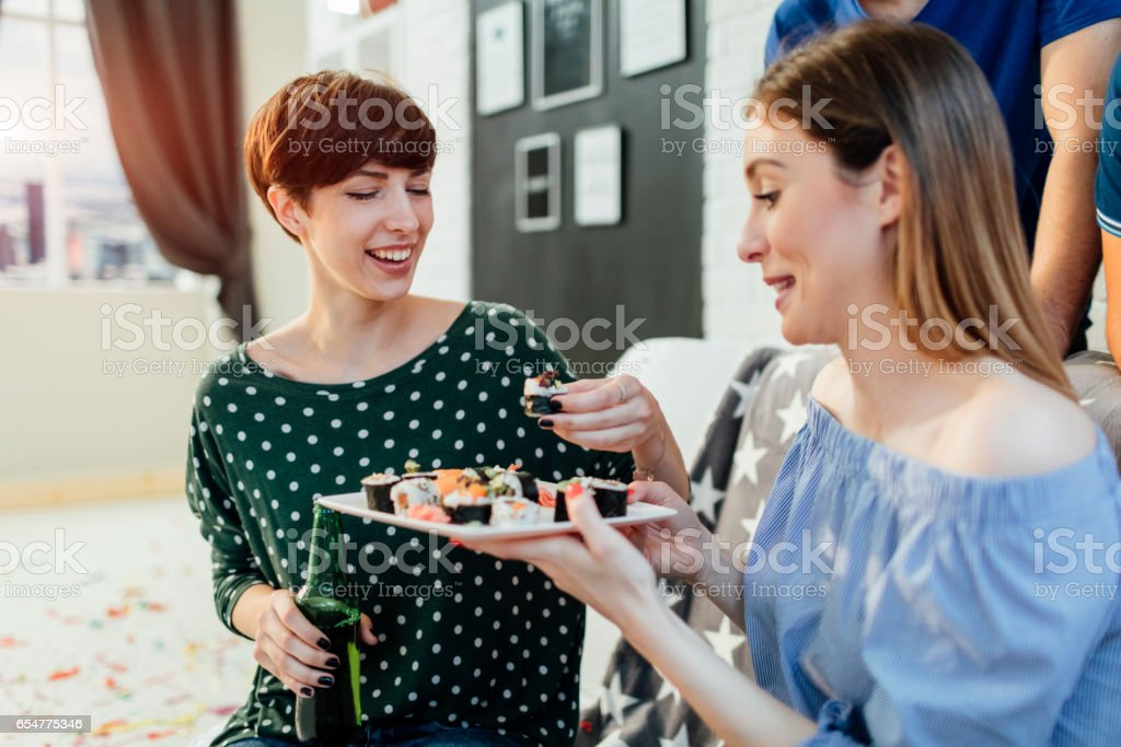 Young people having fun at home party. stock photo