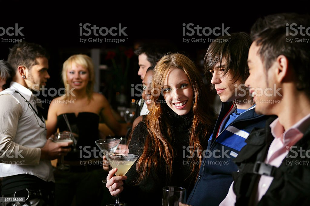 Young people having fun in a bar royalty-free stock photo