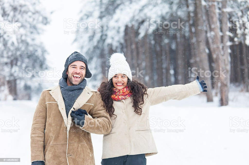 Young people having fun in snow forest stock photo