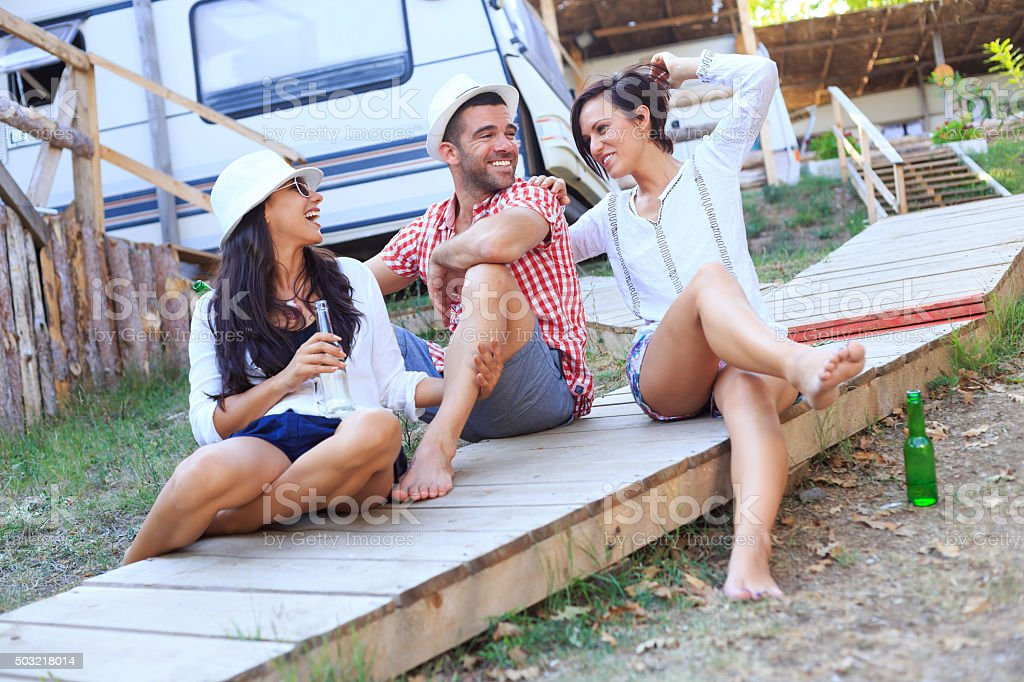Young people having fun near the caravan stock photo