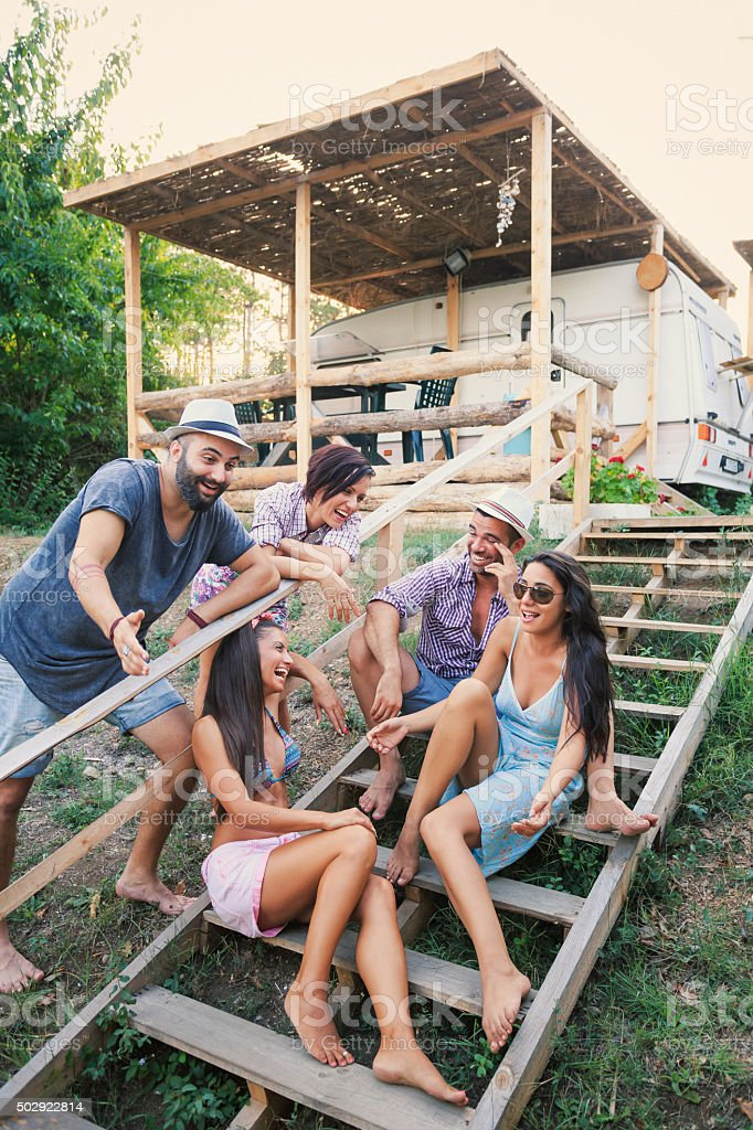 Young people having fun on stairs outdoor stock photo