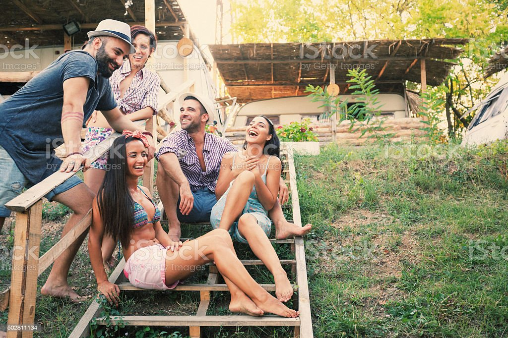 Young people having fun on stairs outdoor-copy space stock photo