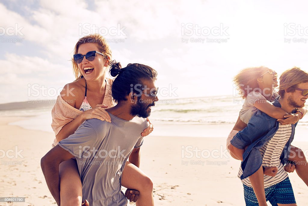 Young people having fun on the beach stock photo