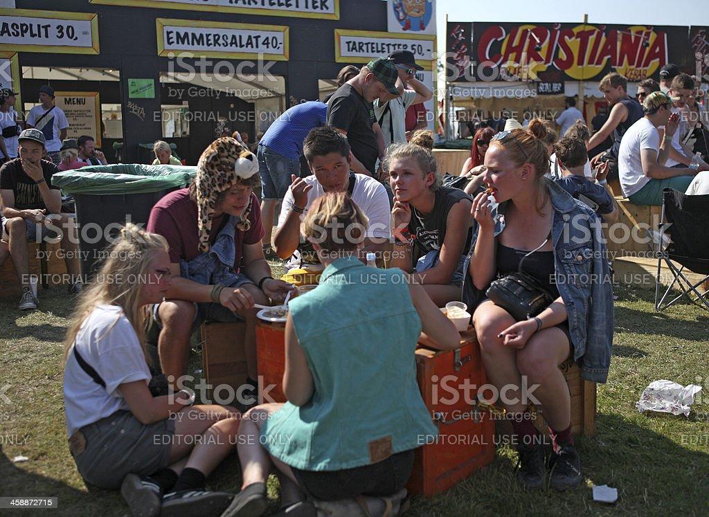 Young people having lunch break - Music Festival Roskilde, Denmark stock photo