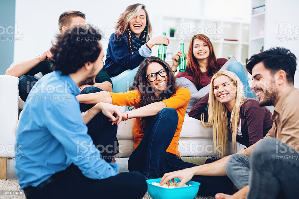 Young people having party at home stock photo