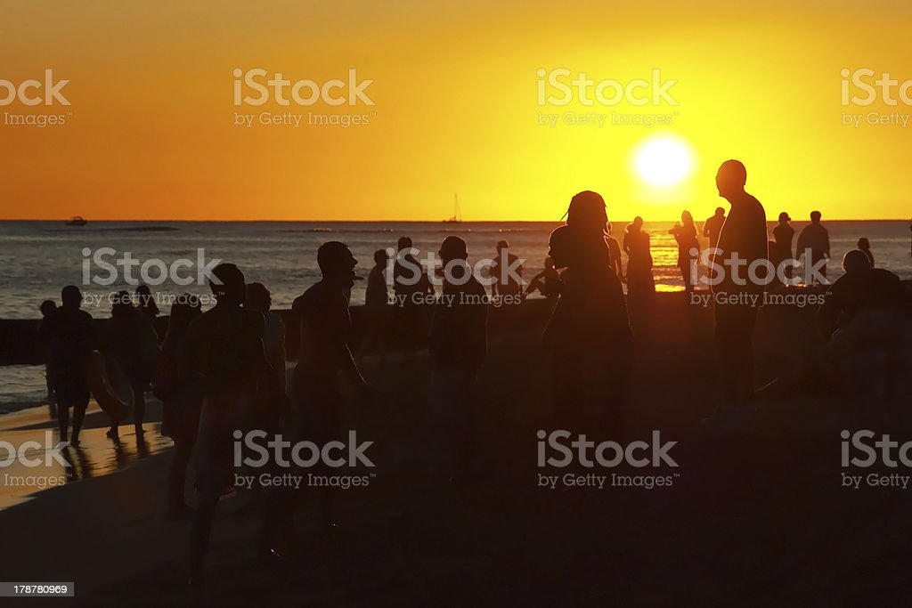 Young people having party on beach during the sunset royalty-free stock photo