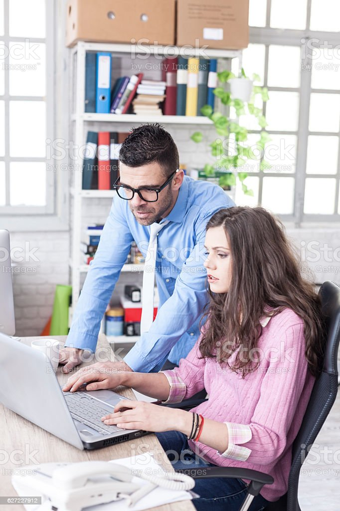 Young people having problems in workplace stock photo
