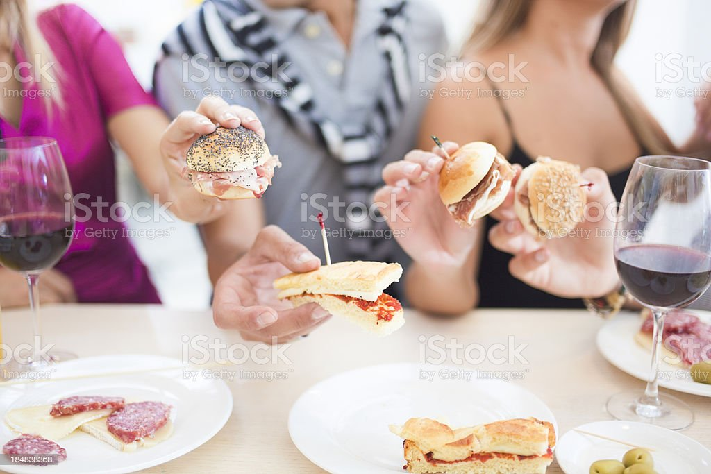 Young people having snacks in bar stock photo