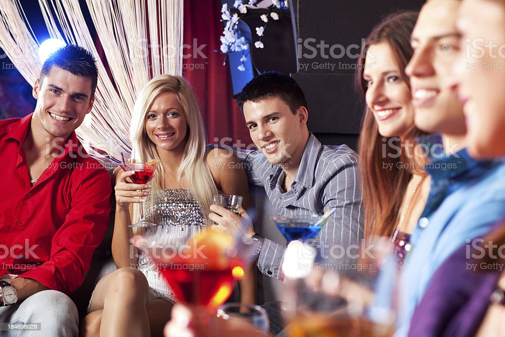 Young people holding drinks at the bar royalty-free stock photo