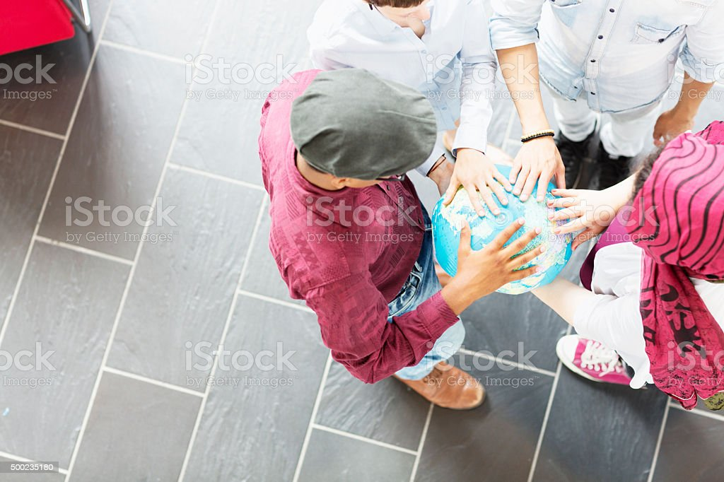 young people holding globe earth stock photo