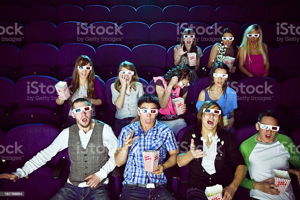 Young people in 3D move theater royalty-free stock photo