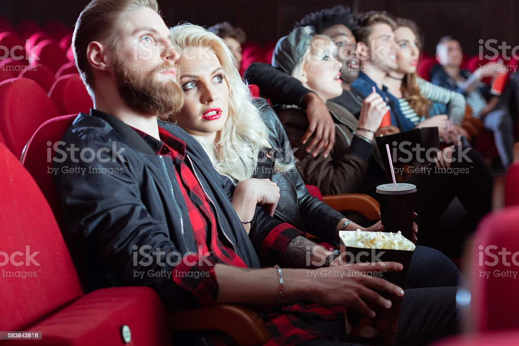 Young people in 3D movie theater stock photo