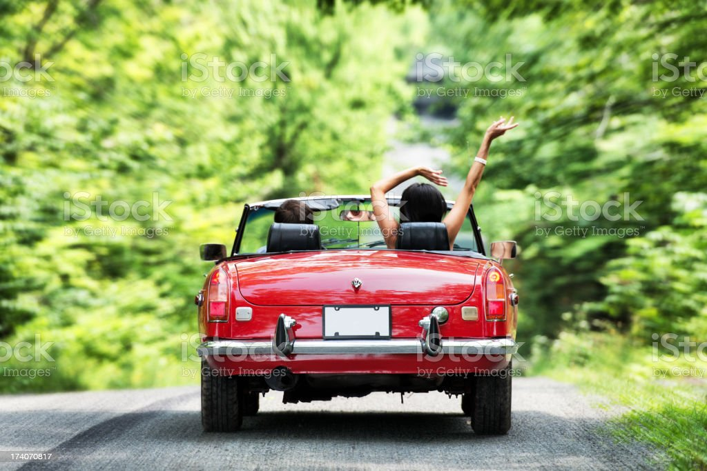 Young people in a cabriolet stock photo