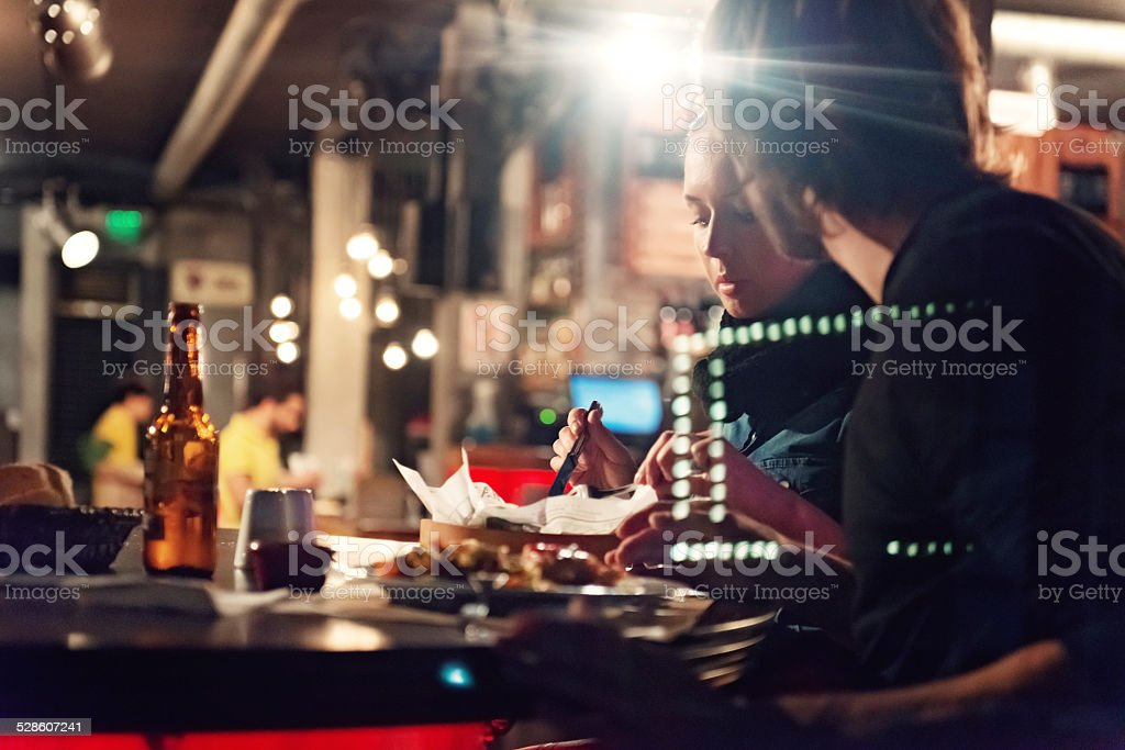 Young people in a club having drink and snack stock photo